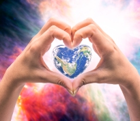 World in heart shape with over women human hands on blurred natural background blue cyan turquoise tree and sky: World Heart health day, CSR concept: Element of this image furnished by NASA